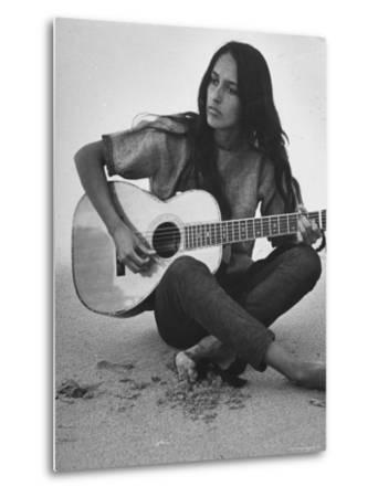 Folk Singer Joan Baez Strumming Her Guitar on the Beach Near Her Home