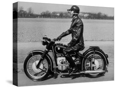 German Made BMW Motorcycle with a Rider Dressed in Black Leather