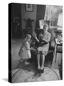 Grandmother Playing with Her Granddaughter by Ralph Crane