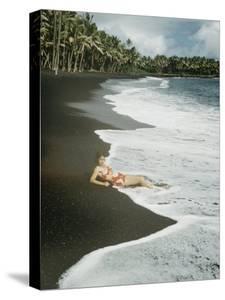 Hawaiian Airline Stewardes on Black Sand Beach, Kalapana, Hawaii by Ralph Crane