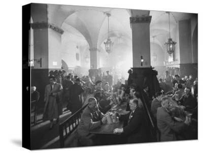 Interior of Munich Beer Hall, People Sitting at Long Tables, Toasting