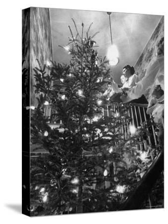 Mrs. George Sutton and Her Family Decorating Their Christmas Tree at Home