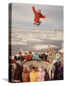 Native Alaskans Playing a Game of Nulukatuk, in Which Individals are Tossed into the Air by Ralph Crane
