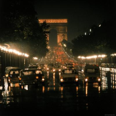 Night Time Traffic Streaming Down the Champs Elysees with the Arc de Triomphe in Background