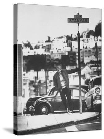 Poet Rod McKuen Swinging from Sign Which is Title of One His Songs, Stanyan Street
