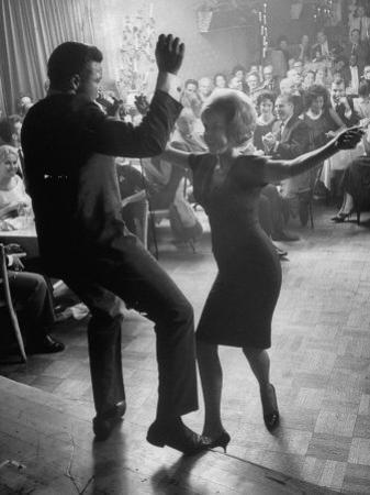 """Pop Singer Chubby Checker Singing His Hit Song """"The Twist"""" on Dance Floor at Crescendo Nightclub"""