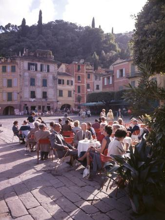 Sidewalk Cafe Sitters Taking in the Evening Sun at Portofino, Italy