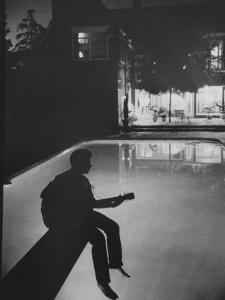 Singer Ricky Nelson Playing Guitar on Poolside by Ralph Crane