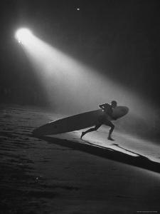 Surfboard Rider Racing Into Water with Board in Relay Race at International Surf Festival by Ralph Crane