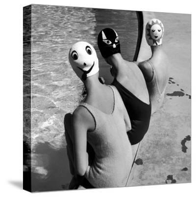 Women Modeling Bathing Caps with Faces on Them