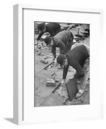 Workers Paving Sidewalk in Front of Stalin Statue Are Making Highest Salaries at 24 Cents Per Hour