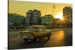 A classic American car in on a street in Old Havana. by Ralph Lee Hopkins