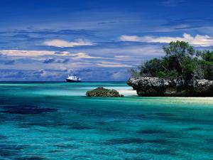 Expedition Ship Nearing Island, Seychelles by Ralph Lee Hopkins