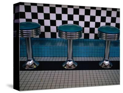 Stools at Classic Diner with Checkerboard Tiling, New Mexico, USA