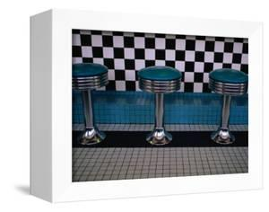 Stools at Classic Diner with Checkerboard Tiling, New Mexico, USA by Ralph Lee Hopkins