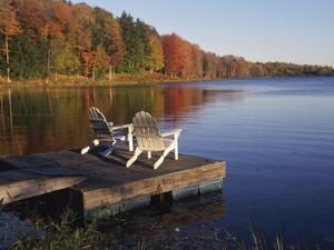 Adirondack Chairs on Dock at Lake by Ralph Morsch