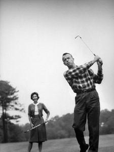 Astronaut Alan B. Shepard and His Wife Playing Golf by Ralph Morse
