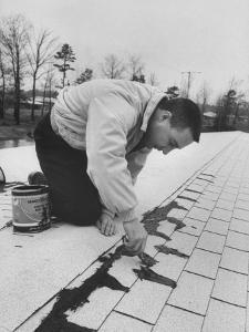 Astronaut Virgil I. Grissom Using Roof Cement at Home by Ralph Morse