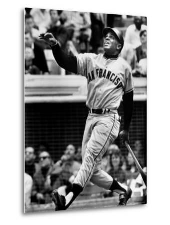 Baseball Player Willie Mays Watching Ball Clear Fence for Home Run in Game with Dodgers