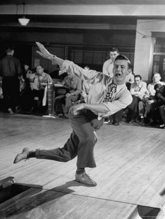 Bob Jones Bowling with a Cigar Hanging Out of His Mouth
