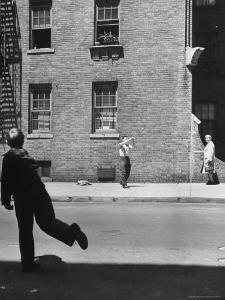 Boy Hitting Ball During Game of Stickball by Ralph Morse