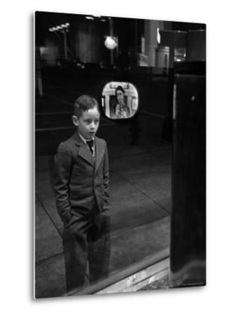 Boy Watching TV on Store Window Set, Glass Reflects the Image Off TV Screen