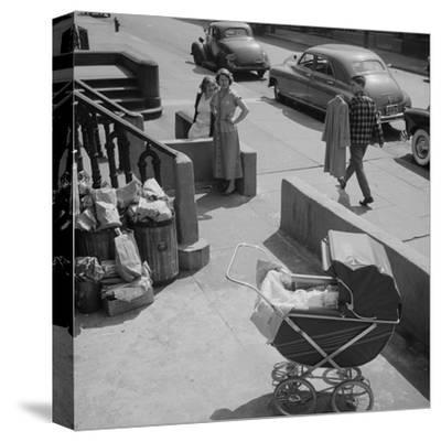 Brooklyn Street Scene, Baby Carriage, Two Women, and a Boy Carrying Dry Cleaning, NY, 1949
