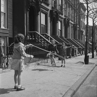 Children Jump Roping on Sidewalk Next to Brooklyn Brownstones, NY, 1949
