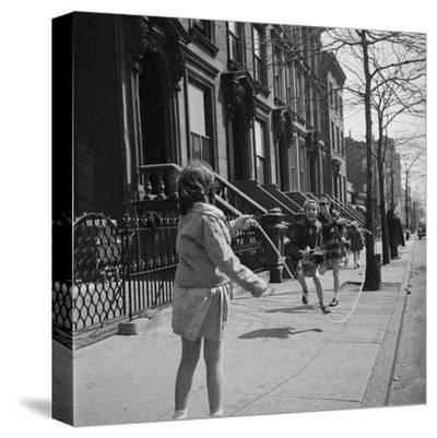 Children Jump Roping on Sidewalk Next to Brooklyn Brownstones, NY, 1949