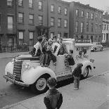 """Boys Playing Stickball in Vacant Lot Next to Drake's Cake and Movie """"Carnegie Hall""""-Ralph Morse-Photographic Print"""