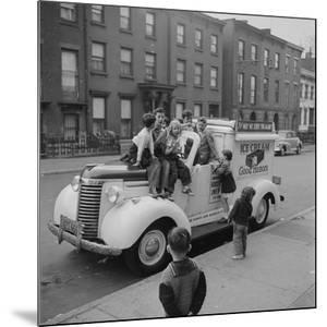Children Sit on the Ice Cream Truck in Brooklyn by Ralph Morse