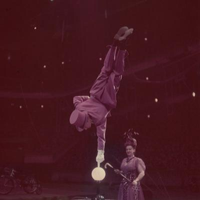 Circus Performer Balancing on Forefinger