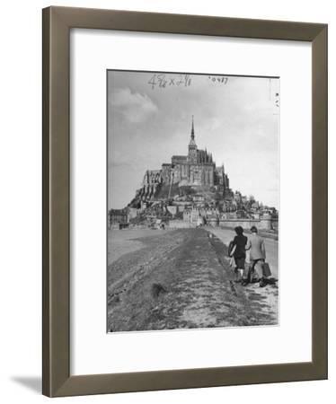 Couple Walking on Causeway Toward Mont Saint Michel