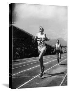 England's Dr. Roger Bannister Beating Australia's Mile Record Holder John Landy by Ralph Morse