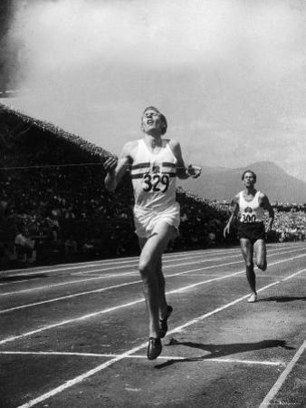 England's Dr. Roger Bannister Beating Australia's Mile Record Holder John Landy