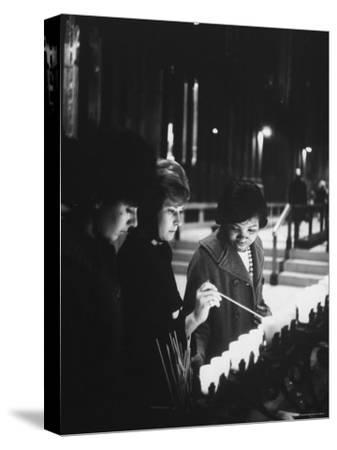 Girls Lighting Votive Candles at a Shrine in St. Patrick's Cathedral, in Prayer For John F. Kennedy