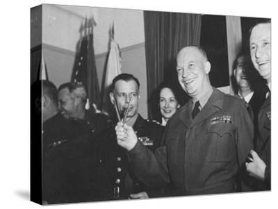 Jubilant Gen. Dwight Eisenhower Holding Pens in V for Victory