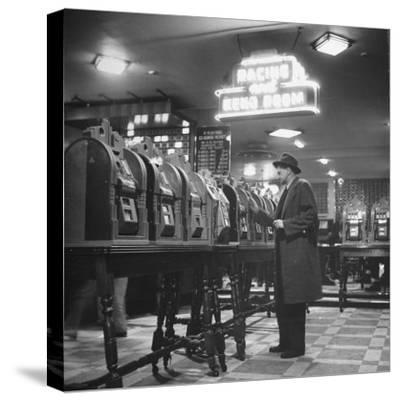 Man Playing the Slot Machines