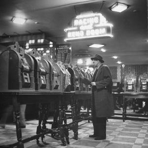 Man Playing the Slot Machines by Ralph Morse