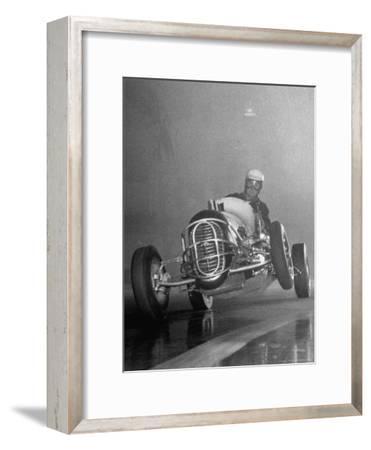 Man Racing in the Midget Auto Race