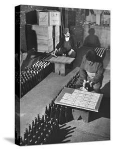 Men Putting Labels on Wine Bottles by Ralph Morse