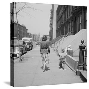Mother and Son Walking Down Brooklyn Street Together, NY, 1949 by Ralph Morse
