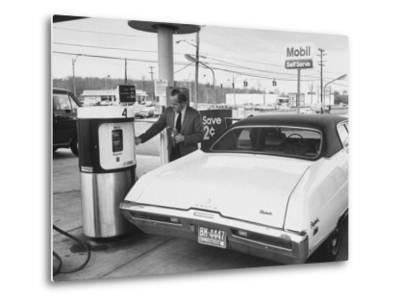 Motorist Filling Up His Own Car at a Self Service Gas Station