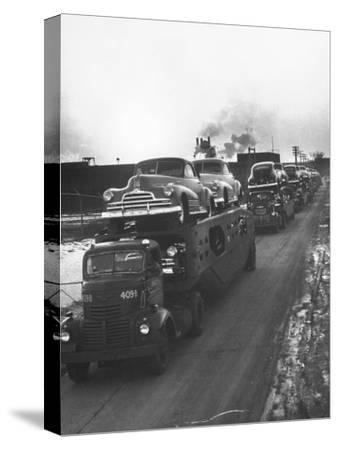 Newly-Made Pontiacs Being Transported on Trucks