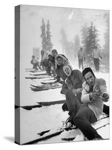 People Playing Tug of War During Snowstorm at Timberline Lodge Ski Club Party by Ralph Morse