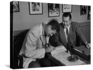 Player Ted Williams Signing Contract with Red Sox Manager, Thomas A. Yawkey by Ralph Morse