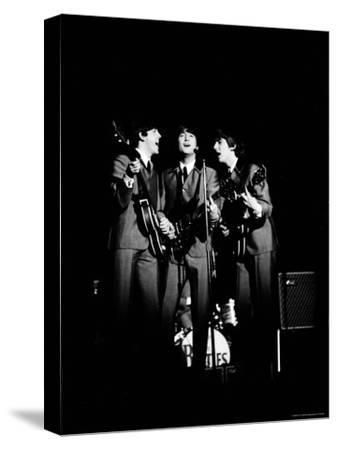 Pop Music Group the Beatles in Concert Paul McCartney, John Lennon, George Harrison