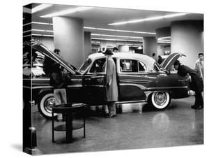 Prospective Buyers Looking over New Dodge Royal at Chrysler Show Room by Ralph Morse