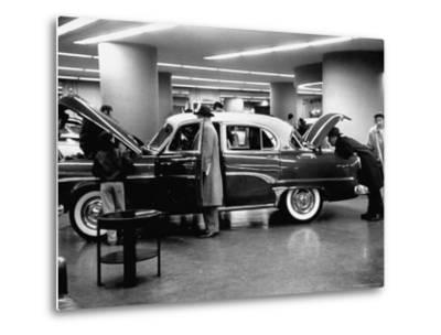 Prospective Buyers Looking over New Dodge Royal at Chrysler Show Room