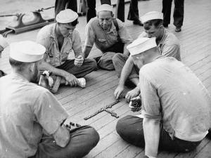 Sailors Aboard a Us Navy Cruiser at Sea Playing a Game of Dominoes on Deck During WWII by Ralph Morse